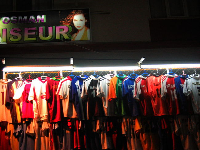 Clothing Collection For Sale Illuminated In A Row Large Group Of Objects Market Market Stall Multi Colored Night No People Publicity Shop Side By Side Side Town Store T Shirts Turkey