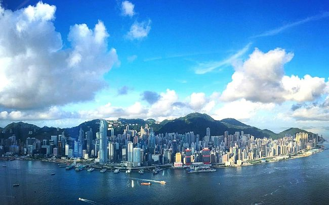 City Waterfront Architecture Water Built Structure Building Exterior Cityscape Mountain Mountain Range City Life Sky Cloud - Sky Travel Destinations Urban Skyline Tall - High Sea Tower Growth Development Skyscraper Hong Kong Victoria Harbour