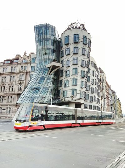 Tram and a floating house Be. Ready. The Graphic City Mobility In Mega Cities