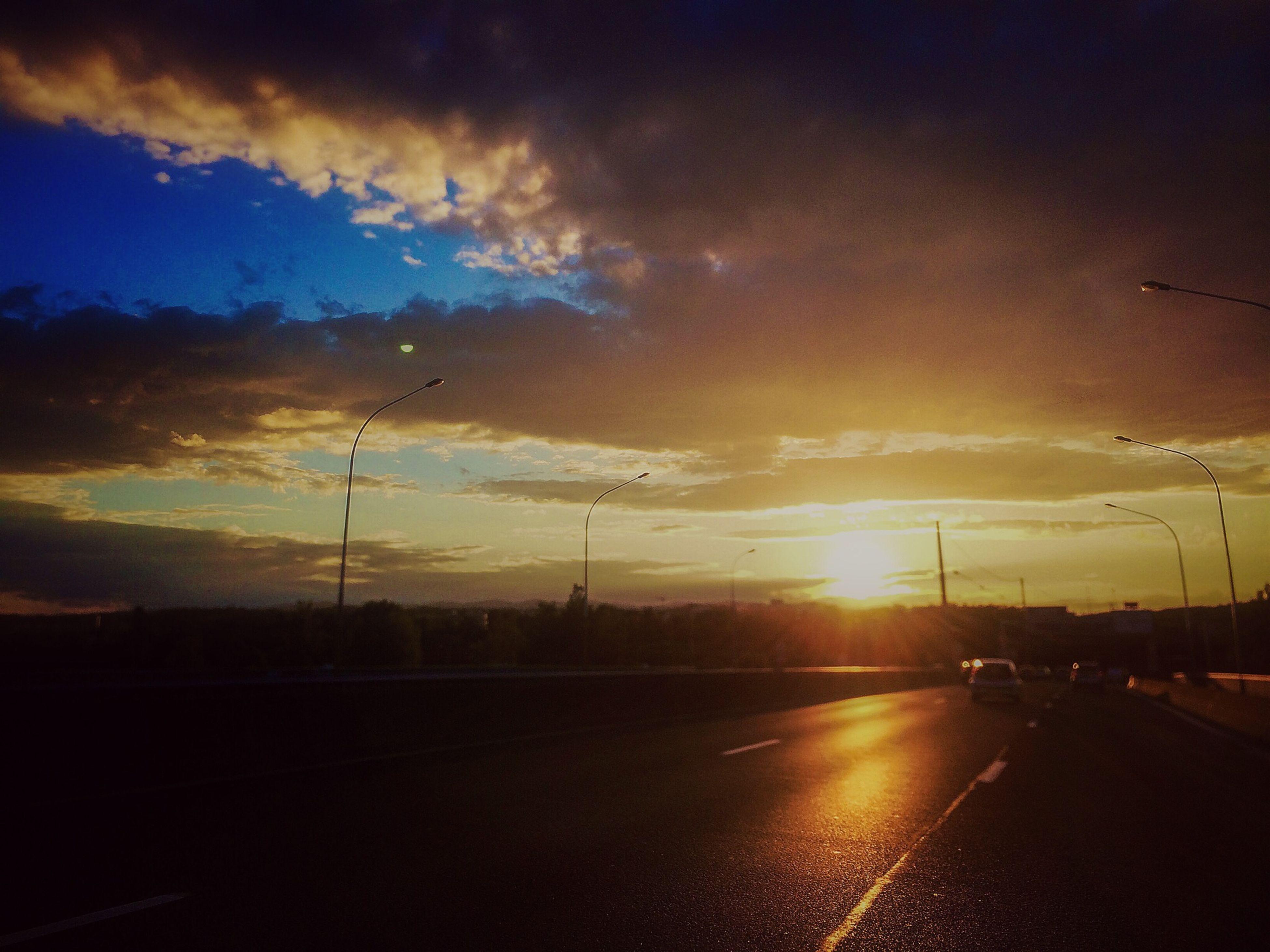 sunset, sky, transportation, silhouette, road, street light, cloud - sky, car, sun, street, electricity pylon, orange color, the way forward, nature, land vehicle, cloud, scenics, mode of transport, outdoors, beauty in nature