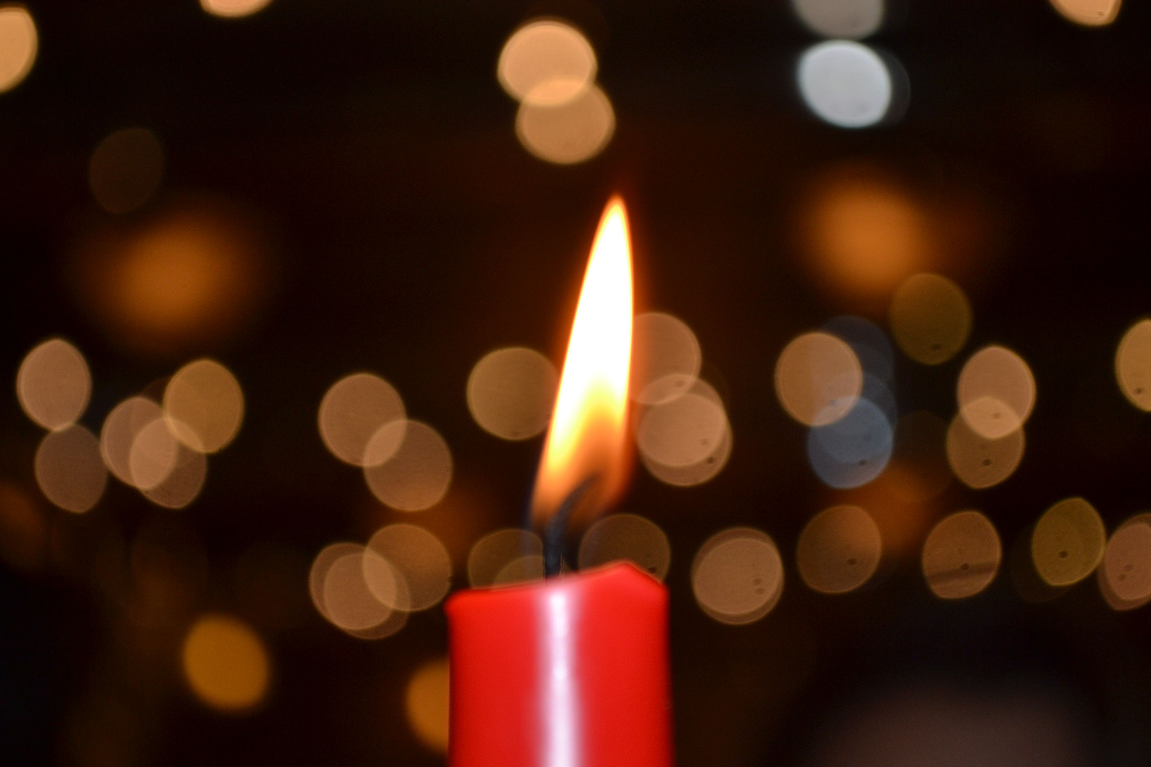 illuminated, glowing, indoors, multi colored, close-up, lighting equipment, defocused, night, circle, light - natural phenomenon, abstract, selective focus, candle, flame, in a row, pattern, backgrounds, no people, red, focus on foreground