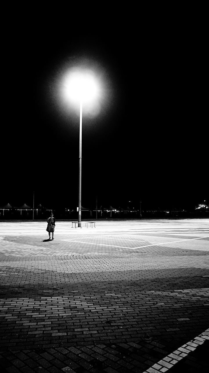 night, illuminated, real people, street light, outdoors, one person, full length, sky, people