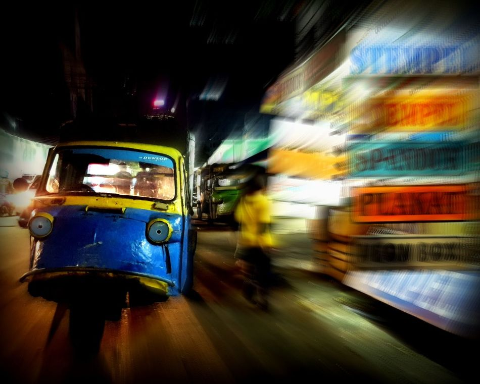 """this kind of thing always tickling me to not make a picture of it , I think because of its unique shape , """"Bemo"""" is a local transportation which is still operate in some area in Jakarta , Indonesia Colors Transportation Night Public Transportation Outdoors Composition From My Point Of View Bright Colors Oneofthosedays Alonebutnotlonely Still Life Adapted To The City Taking Photos Tadaa Community Streetphoto Nightshot"""