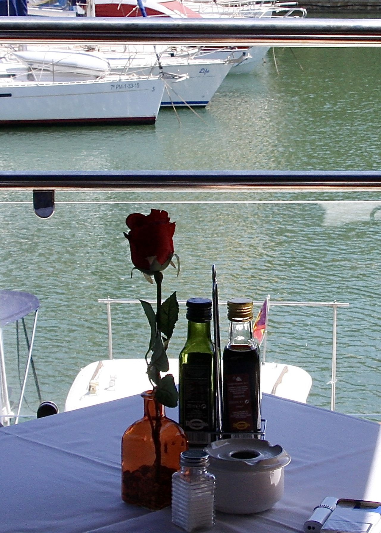 Arrangement Cigarettes Rose - Flower EyeEm Best Shots Flower Food And Drink Harbor Lunch Lunch Time! Mallorca Mediterranean  Mediterranean Sea Nautical Vessel Olive Oil Port Restaurant SPAIN Still Life Table Take Your Place Terrace Travel Water Wine Moments Wineandmore