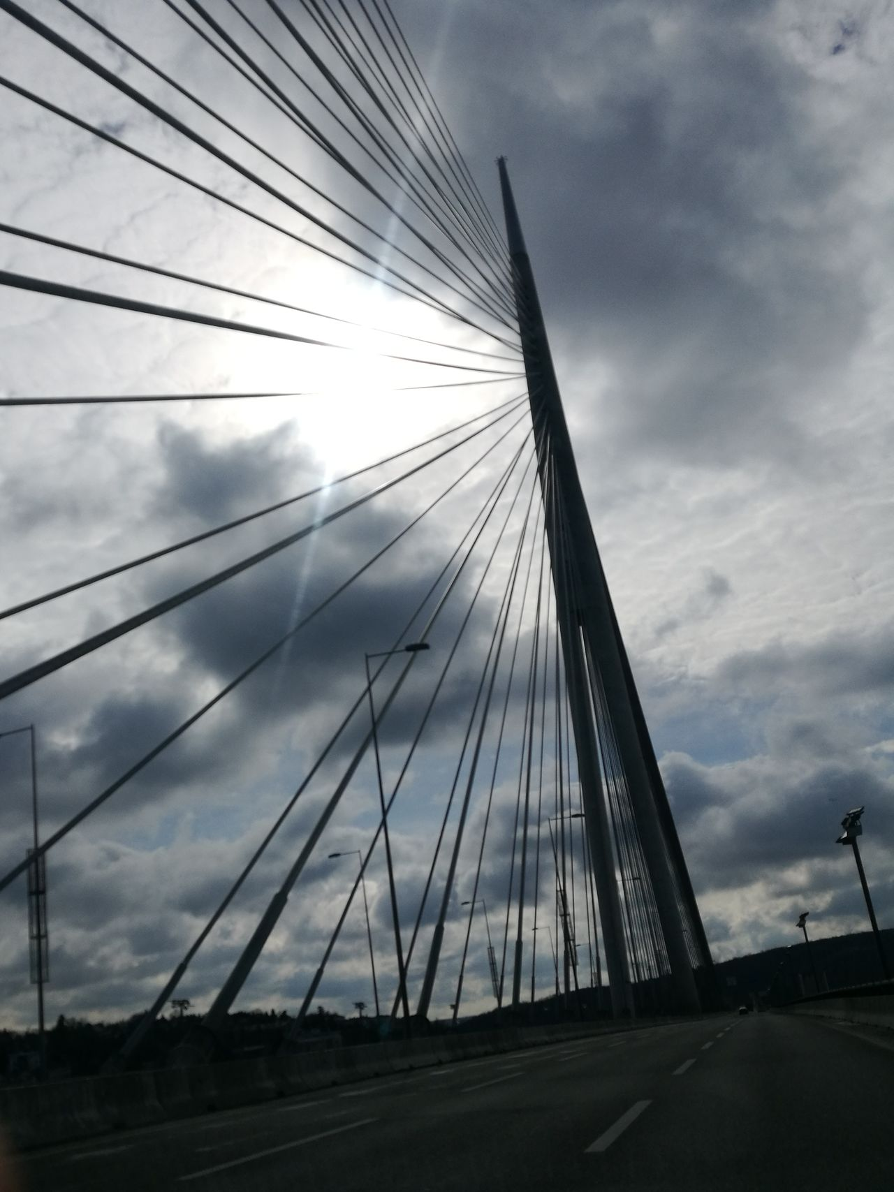 Suspension Bridge Bridge - Man Made Structure Cloud - Sky Transportation Sky Traffic Cable-stayed Bridge Built Structure Road Travel Car Day Connection Travel Destinations Sunlight Sunset Silhouettes Sunbeam Sadness