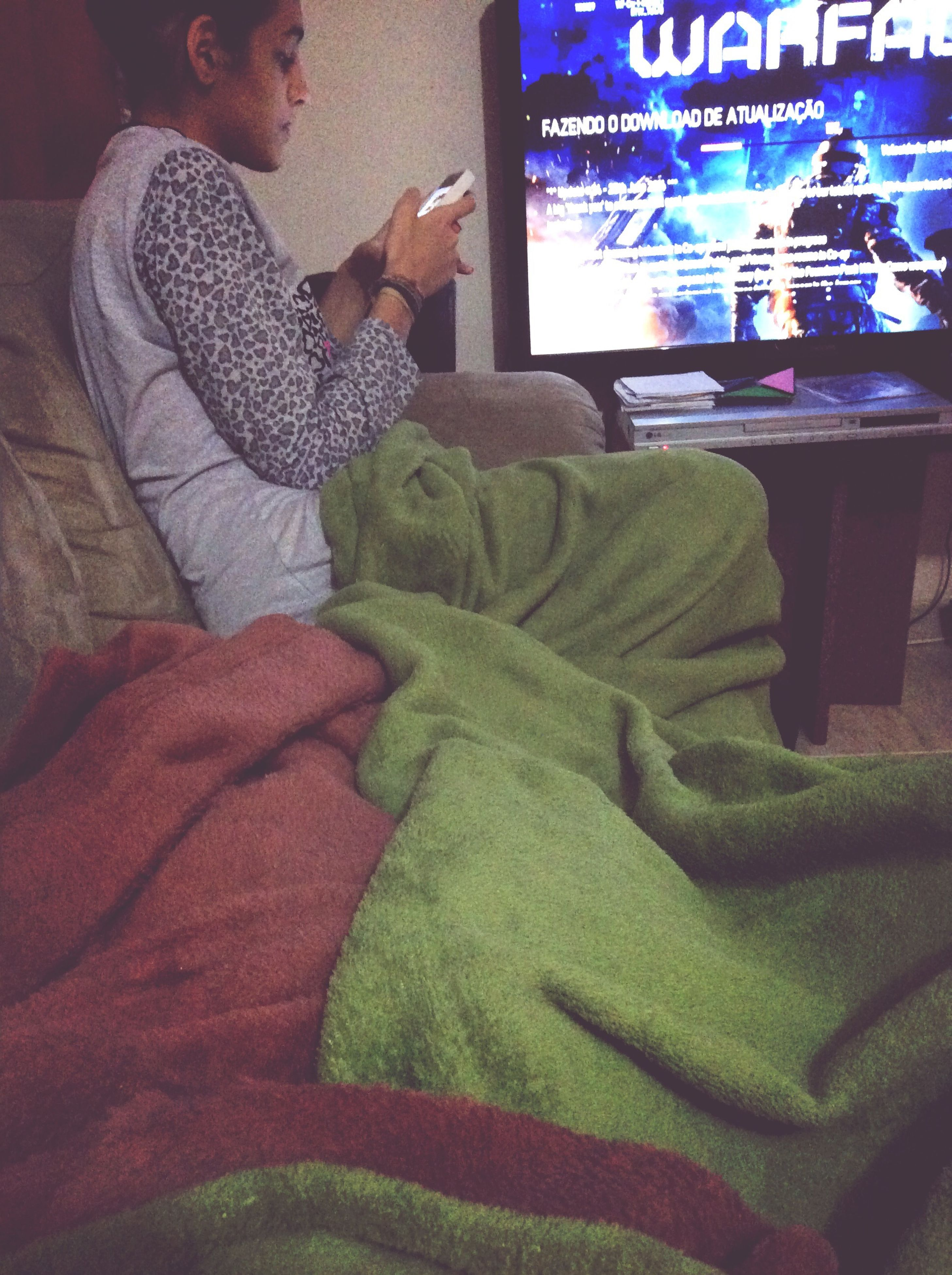 indoors, communication, text, lifestyles, casual clothing, men, home interior, leisure activity, western script, relaxation, sitting, bed, holding, waist up, non-western script, day, high angle view