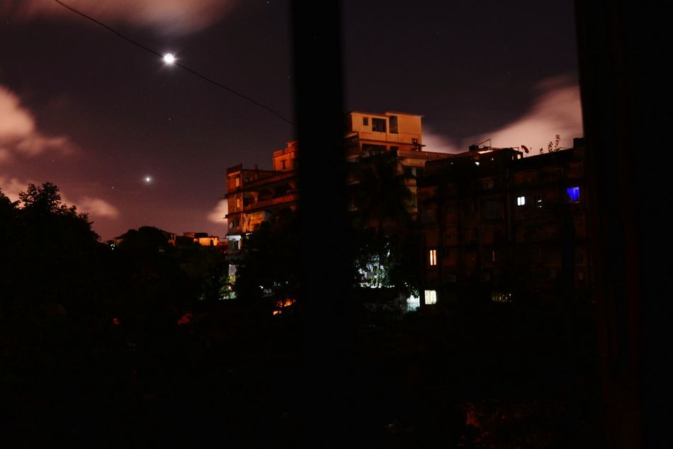 A dramatic Moonlit NIGHT, and the Skyline of my favorite city of joy Kolkata(Nikon D5200 dslr 18-55mm click)!A beautiful creation of the Nature!-Pritam Majumder🌹😍😂😎☁️⛈️🌈⛅🌅🌃🌉🌄👍👌👏✌️✊👌👍 Night Astronomy Illuminated Moon Cityscape Urban Skyline Beauty In Nature EyeEm Diversity