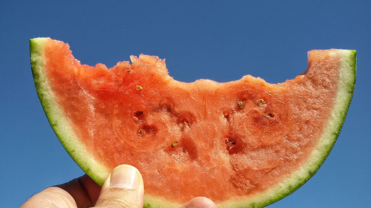 Fresh water melon slice Fruit Water Melon SLICE Human Finger Close-up Food And Drink Healthy Eating Food Sky Fresh Day Red Colour