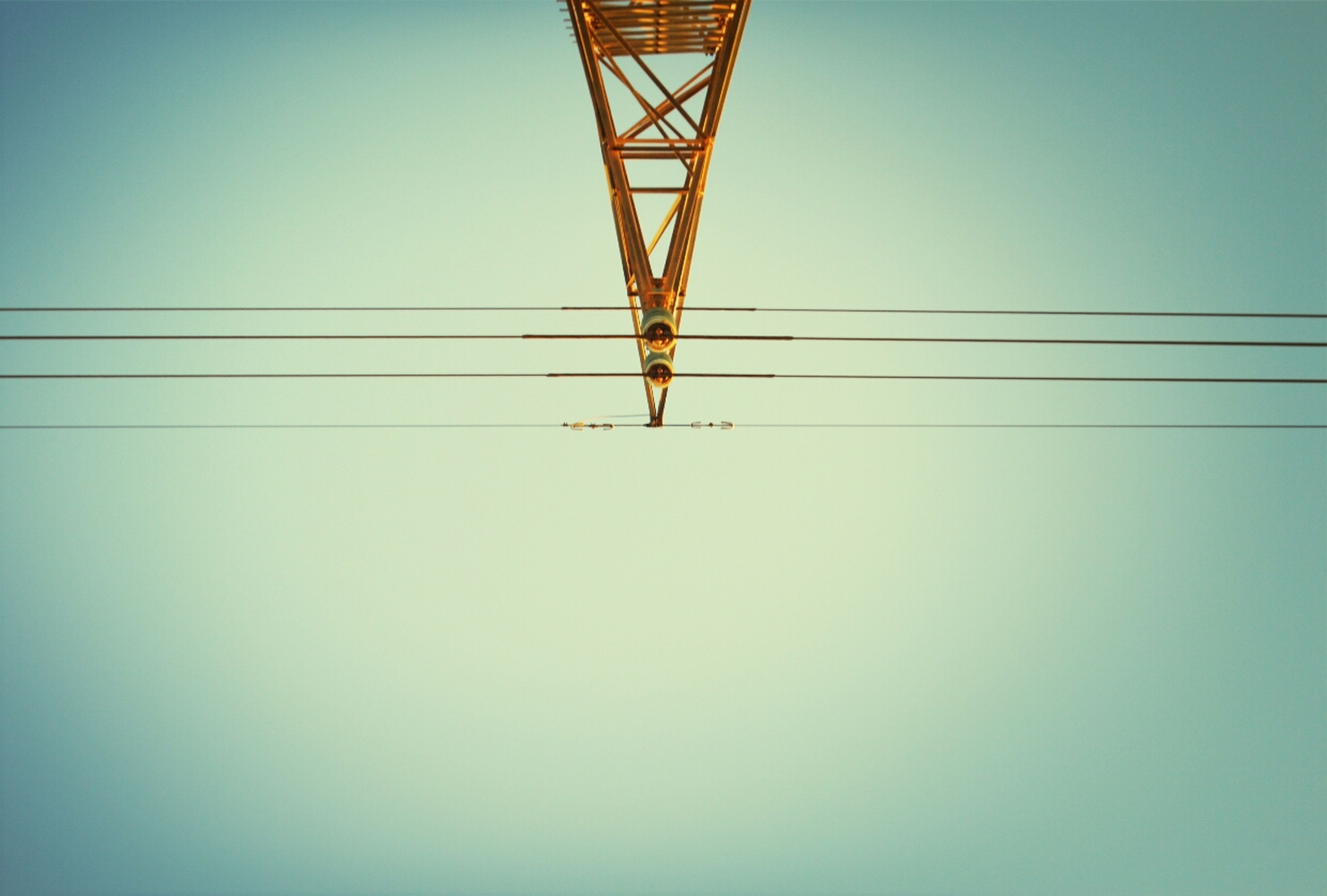 power line, electricity, low angle view, connection, power supply, electricity pylon, cable, clear sky, technology, fuel and power generation, power cable, copy space, sky, blue, no people, outdoors, silhouette, day, complexity, lighting equipment