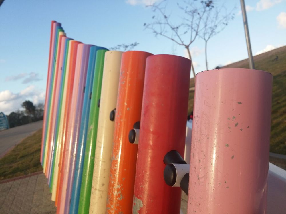Multi Colored No People Outdoors Day Sky Close-up Park Xylophone Metal Pipe Colored Pipes