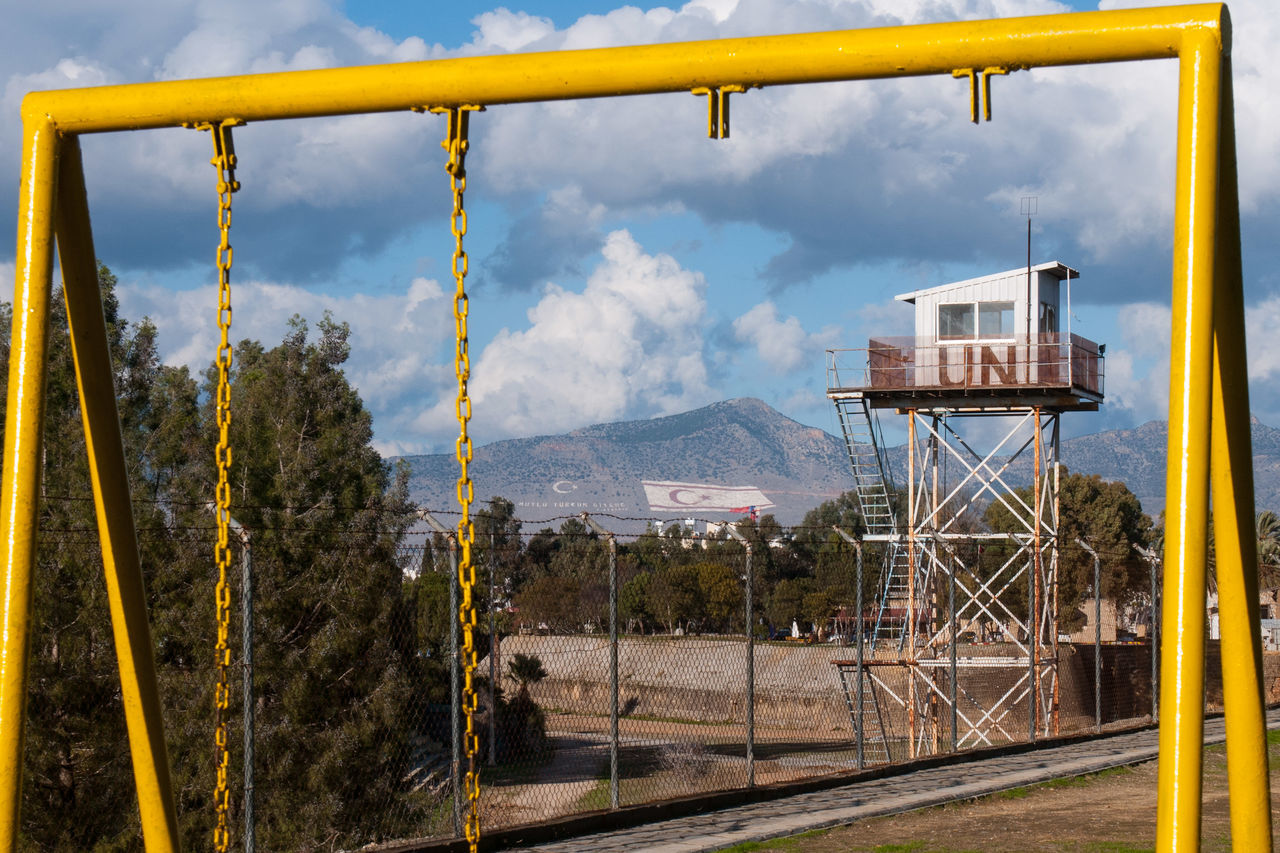 A guard tower of UN buffer zone next to a playground and with the flags of Turkey in the background. Architecture Buffer Zone Cyprus Day Lefkoşa Nature Nicosia, Cyprus No People Onu Outdoors Sky Tree Turkey UN
