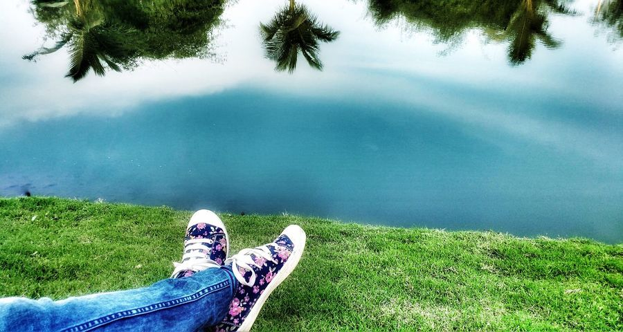 A good day with her 👫 Real People Leisure Activity Grass One Person Green Color Lifestyles Reflection TakenOnPhone Edited On IOS Personal Perspective Nature Water Low Section Outdoors Beauty In Nature Day Shoe Tree Lake Sky