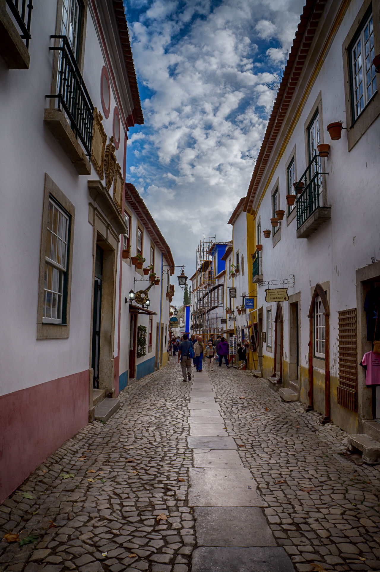 """Óbidos is a Portuguese town in the district of Leiria, in the Centre Portuguese region and close to the Atlantic Ocean coast. The name Óbidos comes from the Latin """"oppidum"""", which means """"fortified city"""". Definitely a """"must see destination"""" on your next trip to this surprising country. Find more here http://bit.ly/1NjgnA5 Architecture Beautiful Building Building Exterior Built Structure Cities City Discovering Europe Exterior Historic Leiria Medieval Narrow Outdoors Photography Places Portugal Street Town Travel Traveling Visiting Window Óbidos"""