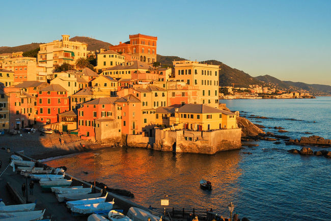 The sea district of Genoa called Boccadasse during the golden hour Architecture Beach Boccadasse City City Cityscape Coast Colored Day Exterior Genoa Genova Golden Hour Houses Italy Liguria Mediterranean  Outdoor Outdoors Sea Sky Sunny Sunset Town Urban