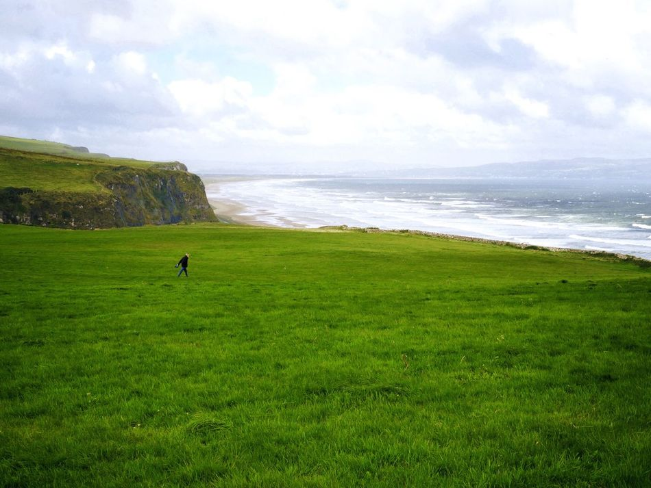 Lost In The Landscape Grass Sea Nature Green Color Sky Scenics Beauty In Nature Tranquil Scene Cloud - Sky Field Tranquility Water Day Horizon Over Water Outdoors Standing Landscape One Person Vacations Real People