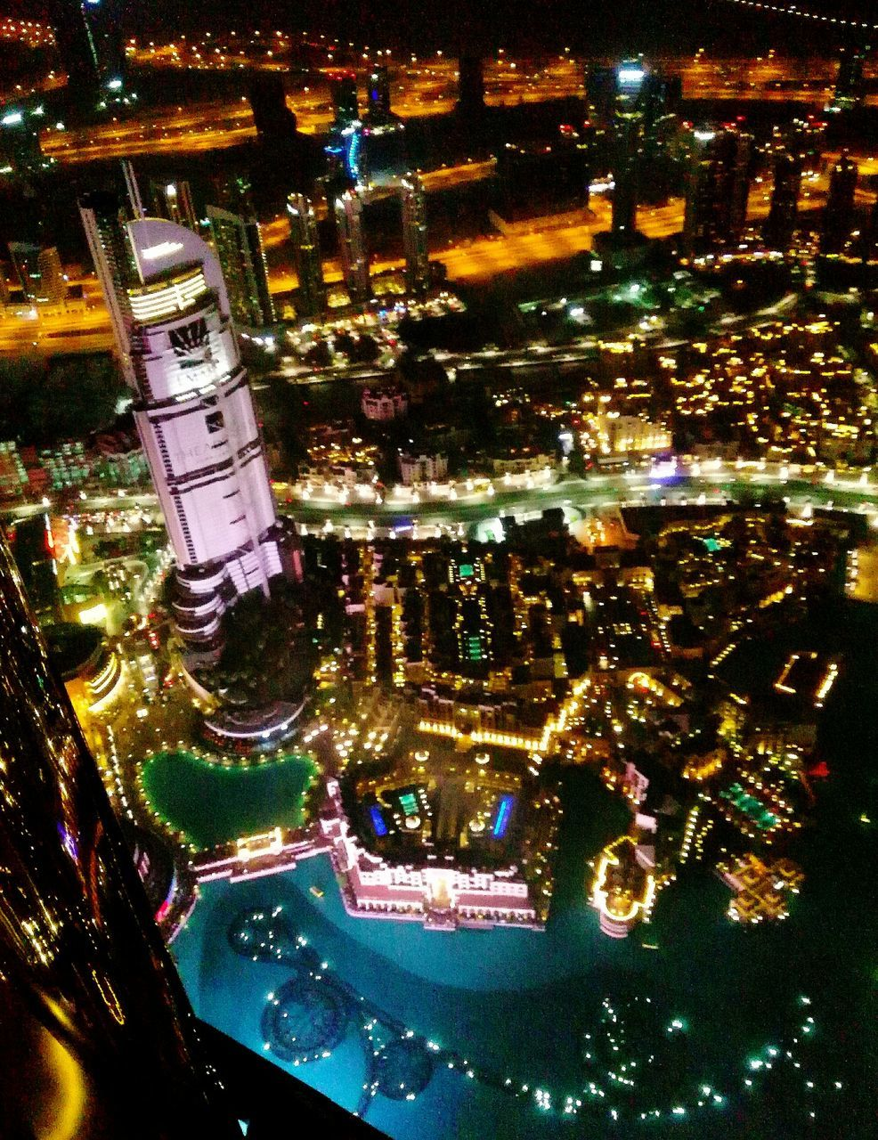 illuminated, night, high angle view, architecture, no people, building exterior, city, indoors, built structure, cityscape, water, close-up