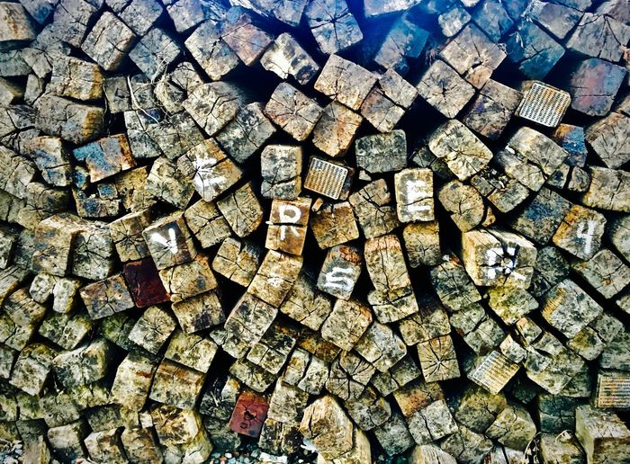 Railroad ties form a colorful, artistic pattern in gentle light. Abstract Form Industrial Photography Industry Natural Beauty Pattern, Texture, Shape And Form Train Tracks Wood Abstract Industrial Landscapes Patterns Patterns & Textures Railroad Railroad Ties Railyard Woodpile