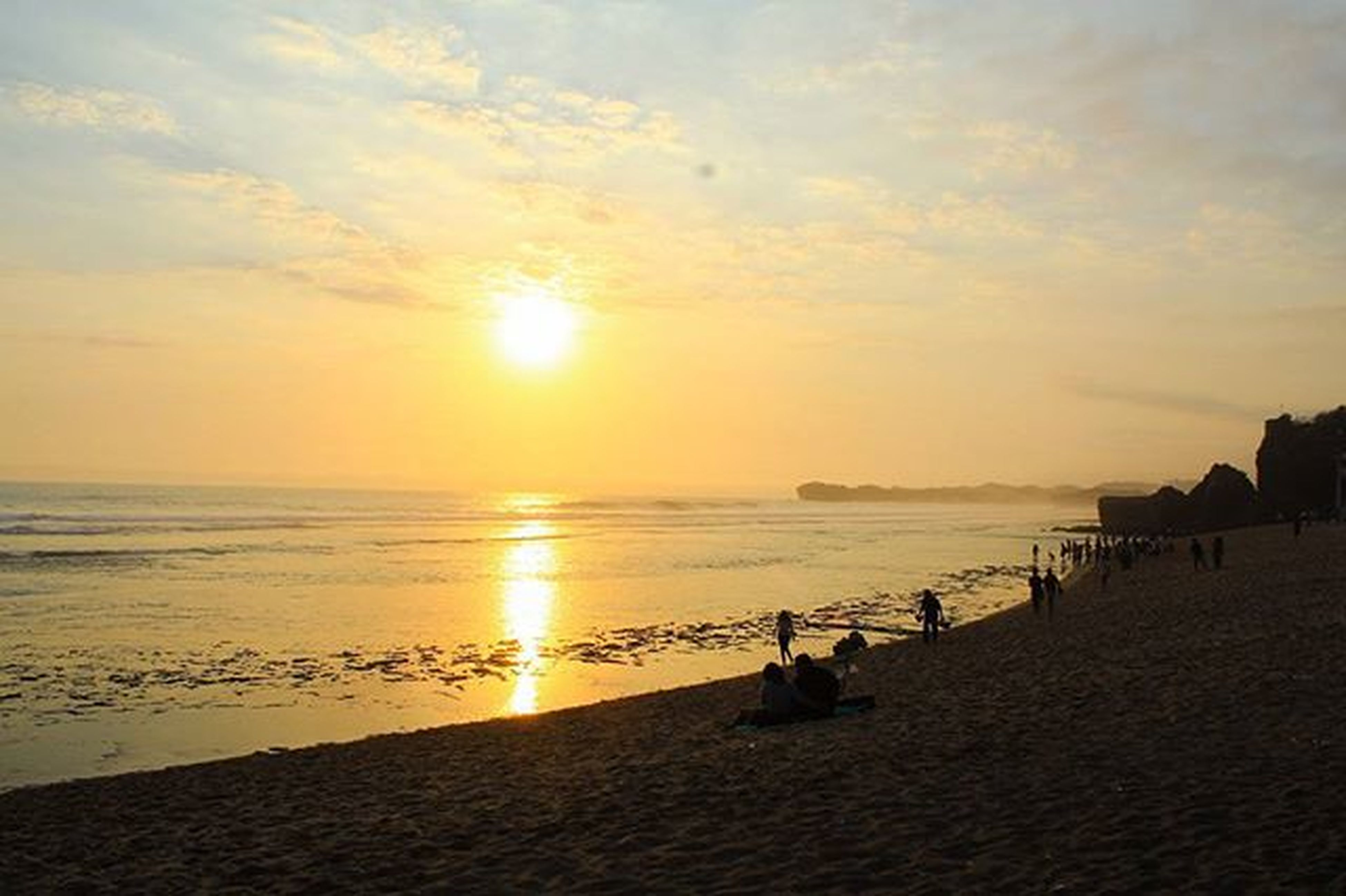 sea, sunset, horizon over water, beach, water, sun, shore, scenics, sky, beauty in nature, tranquil scene, orange color, tranquility, sand, idyllic, nature, sunlight, incidental people, cloud - sky, vacations