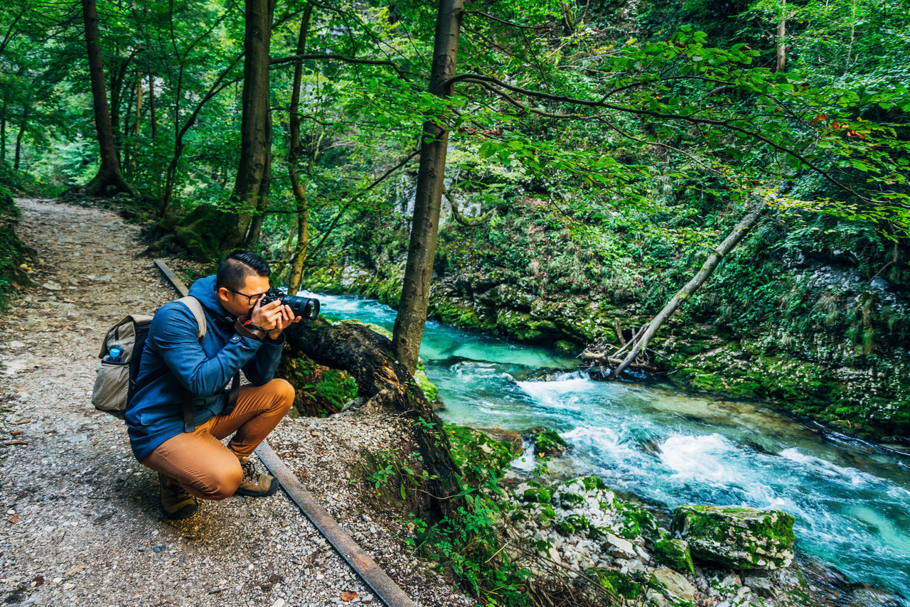 Adult Adults Only Beauty In Nature Crouching Day Eco Tourism Forest Full Length Hiking Men Nature One Man Only One Mid Adult Man Only One Person Only Men Outdoors People Relaxation Tree Water