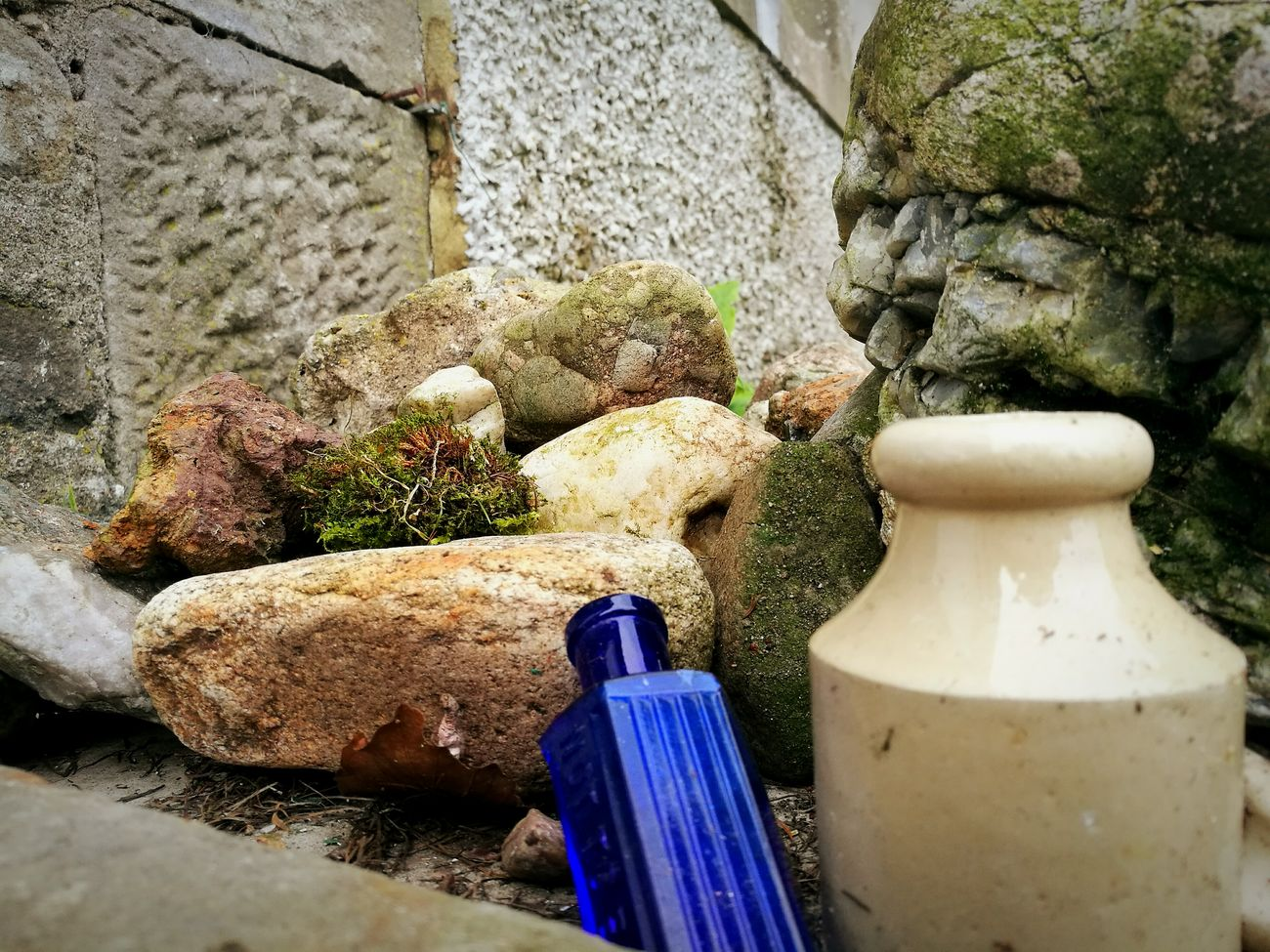 EyeEmNewHere Moss & Lichen Stones Close-up Outdoors Built Structure Old Bottle