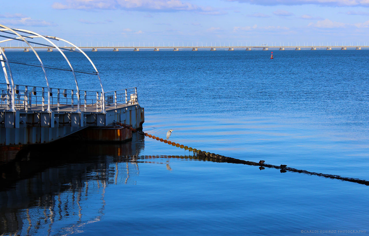 sky, water, outdoors, day, no people, blue, nature, beauty in nature, scenics, built structure, sea, architecture, nautical vessel