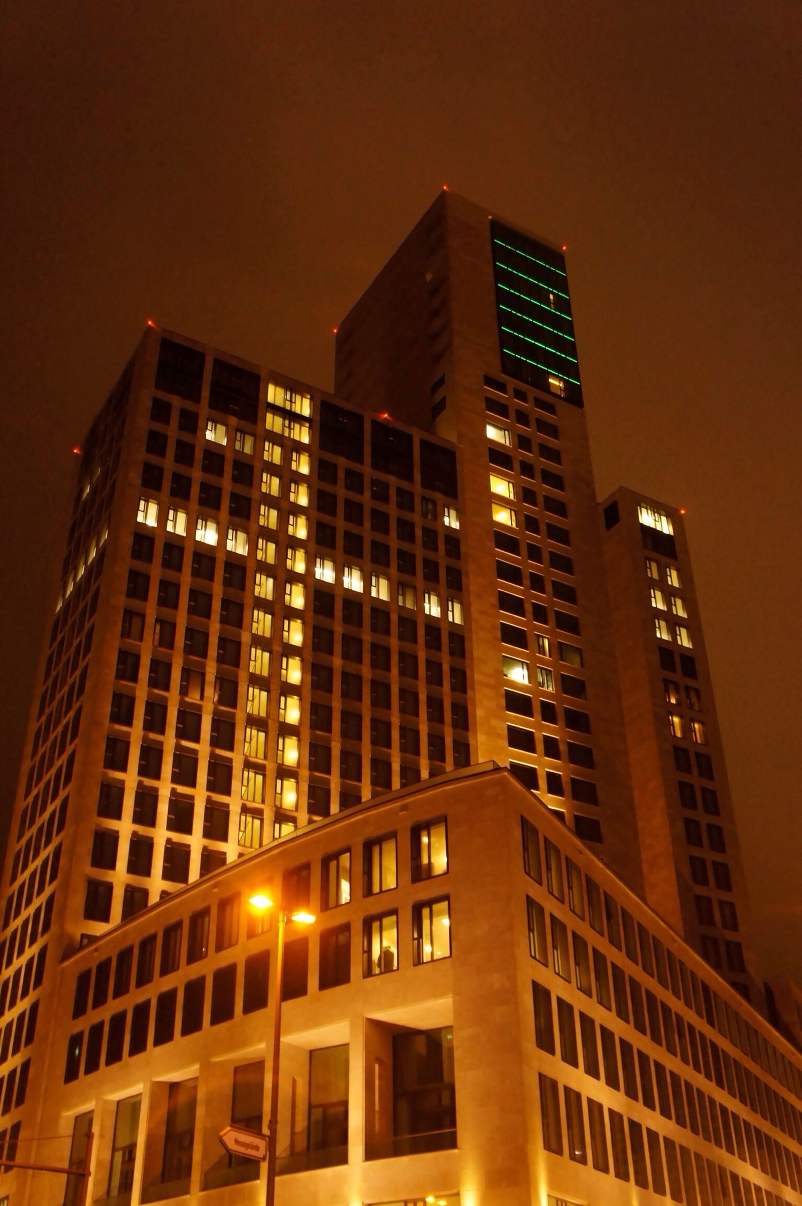 architecture, building exterior, built structure, illuminated, low angle view, city, night, modern, building, office building, skyscraper, window, tall - high, tower, residential building, sky, no people, outdoors, residential structure, street light