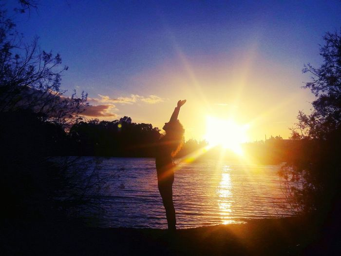 Sunset Nature Nice Day Sunlight sunset #sun #clouds #skylovers #sky #nature #beautifulinnature #naturalbeauty photography landscape Sunshine ☀ Silhouette Back Lit Water One Person Lake Sun People Outdoors Adult Adults Only Only Women One Woman Only Sky Beauty In Nature Tree Day First Eyeem Photo