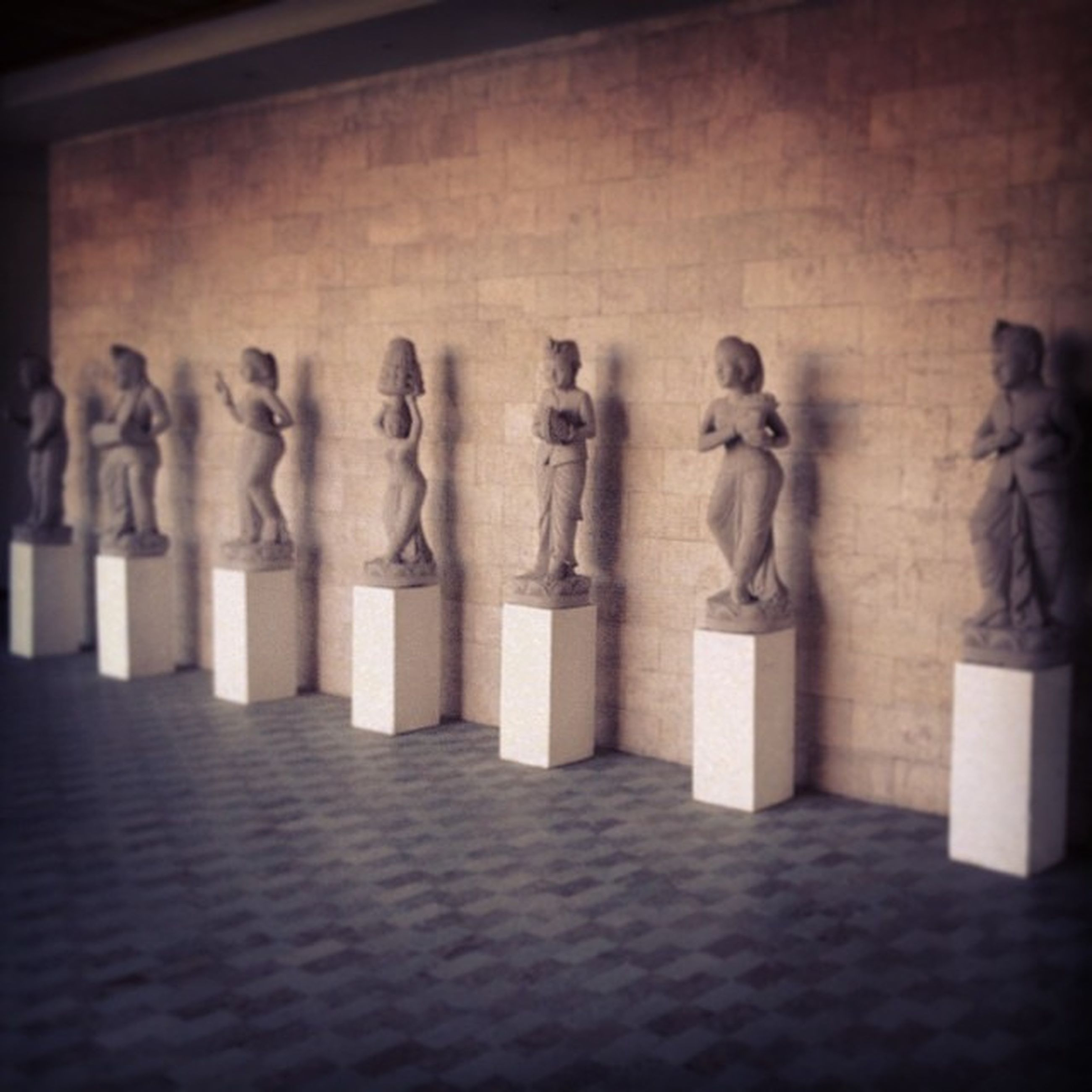 art and craft, art, human representation, creativity, statue, sculpture, in a row, carving - craft product, indoors, animal representation, history, craft, built structure, architecture, side by side, no people, wall - building feature, day