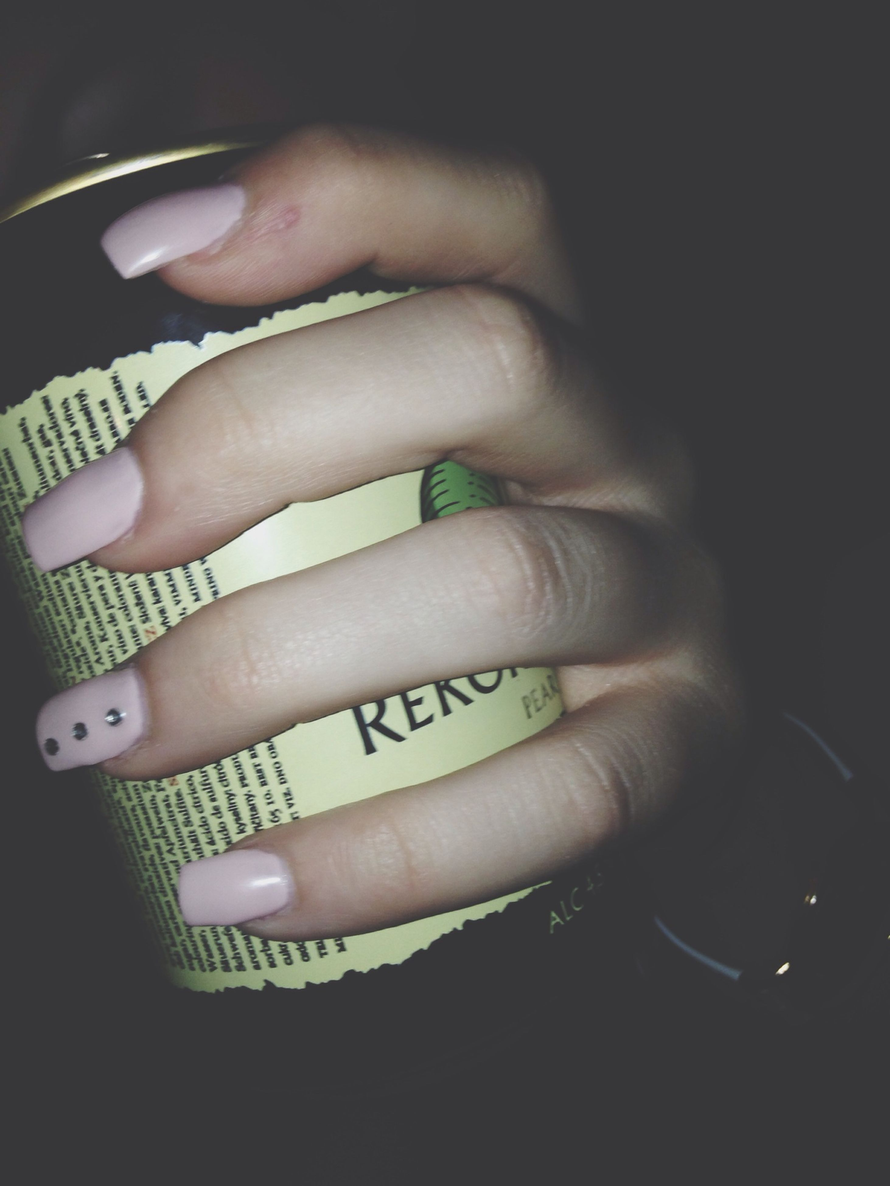 person, indoors, part of, human finger, close-up, cropped, holding, lifestyles, studio shot, black background, unrecognizable person, ring, showing, high angle view, leisure activity, nail polish