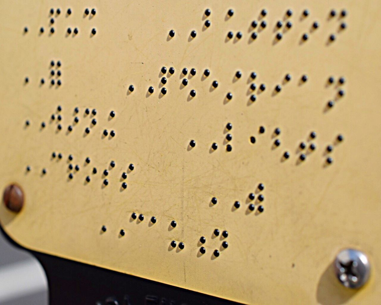 Buttons off the face ~ while crossing an intersection I noticed the raised dots cast a shadow and that a few dots are missing. I wonder if that spells something different. Close-up No People Braille Sign Crosswalk Sign Pedestrian Crossing Day