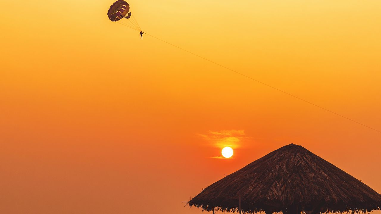 Sunset Orange Color Beauty In Nature Flying Nature Silhouette Scenics Sun Sky Outdoors No People Nature Sun My Year My View Hut Relaxing Paragliding Flying High