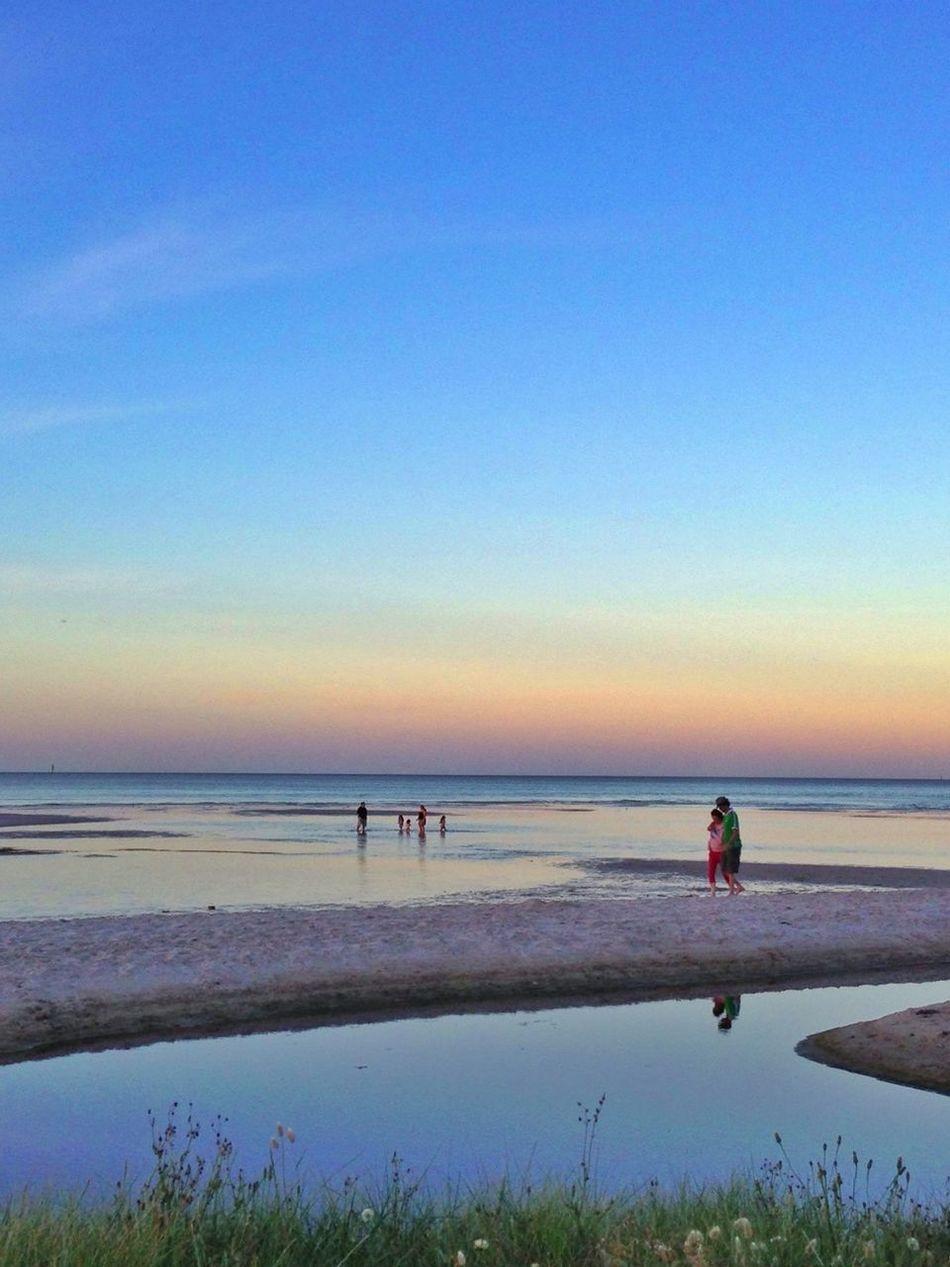 Evening Stroll Along The Beach