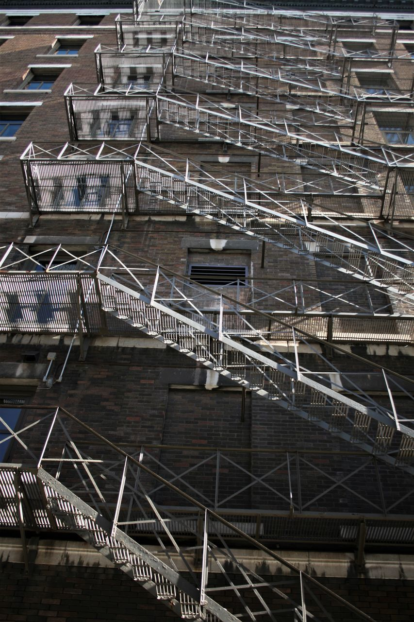 Low Angle View Of Fire Escape On Building In City