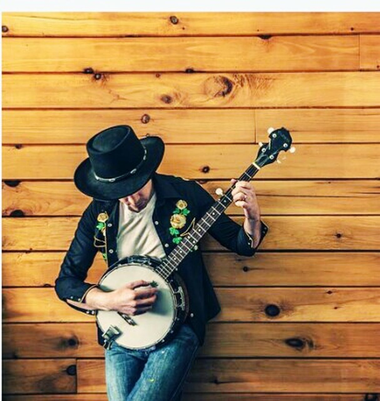 musical instrument, music, guitar, hat, musician, one person, wood - material, holding, one man only, playing, arts culture and entertainment, front view, plucking an instrument, adults only, electric guitar, only men, adult, lifestyles, standing, outdoors, men, young adult, people, performance, day
