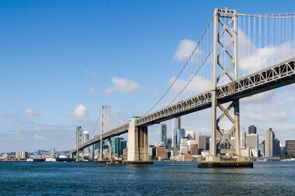San Francisco skyline and Bay Bridge Architecture Bay Bridge Bridge - Man Made Structure Building Exterior Built Structure California City Cityscape Connection Day Nautical Vessel No People Oakland Outdoors River San Francisco San Francisco Bay Sky Suspension Bridge Transportation Travel Travel Destinations Urban Skyline Water Waterfront
