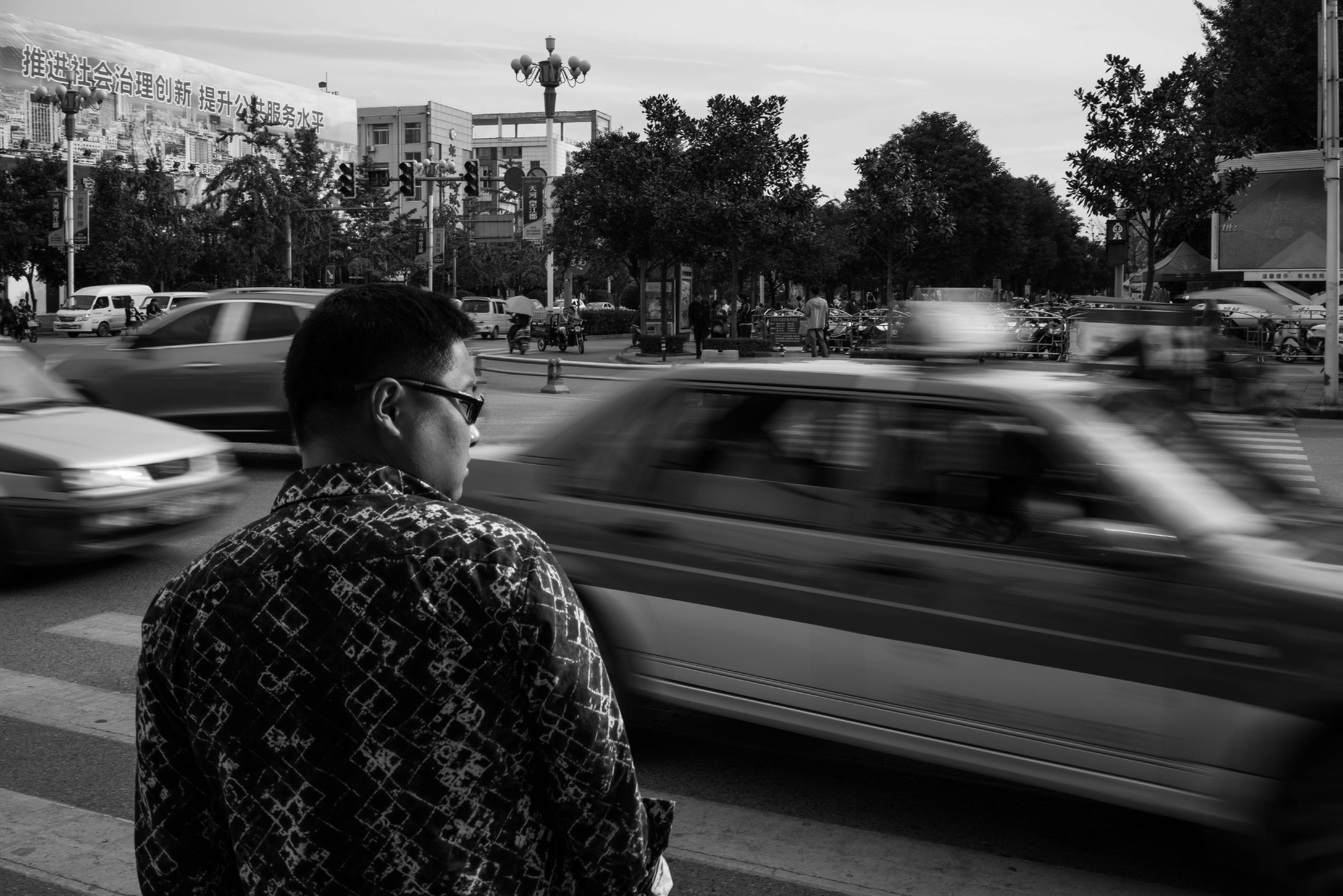 transportation, mode of transport, lifestyles, land vehicle, rear view, car, leisure activity, travel, tree, person, men, public transportation, street, railroad track, vehicle interior, on the move, city life, casual clothing