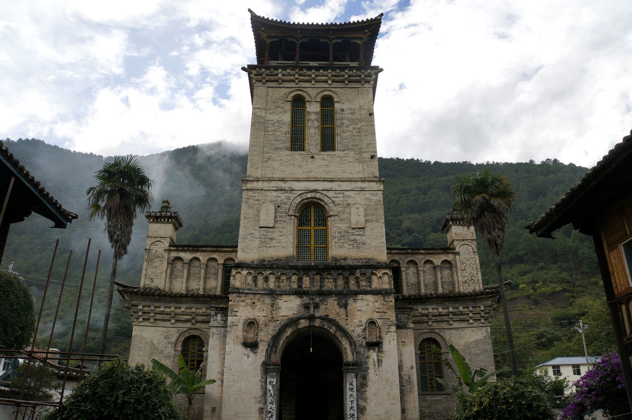 Catholic church in Cizhong, Yunnan Arch Architecture Building Exterior Built Structure China Christianity In China Cizhong Cloud - Sky Day History Low Angle View Mekong Valley No People Outdoors Place Of Worship Religion Sky Spirituality Tibet Tree Yunnan