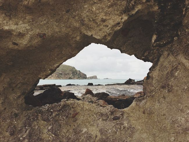 Destroy your fear. only Allah who knows about everything . do not be afraid of fear, say bismillah. make it as a spirit of fear. behind this wall there is a very beautiful beach. if you fear to go further, maybe you will not be able to meet with the beauty behind this wall. with God, insyallah all will be fine. Rock Formation Sea Beach Outdoors Nature Island Cloud