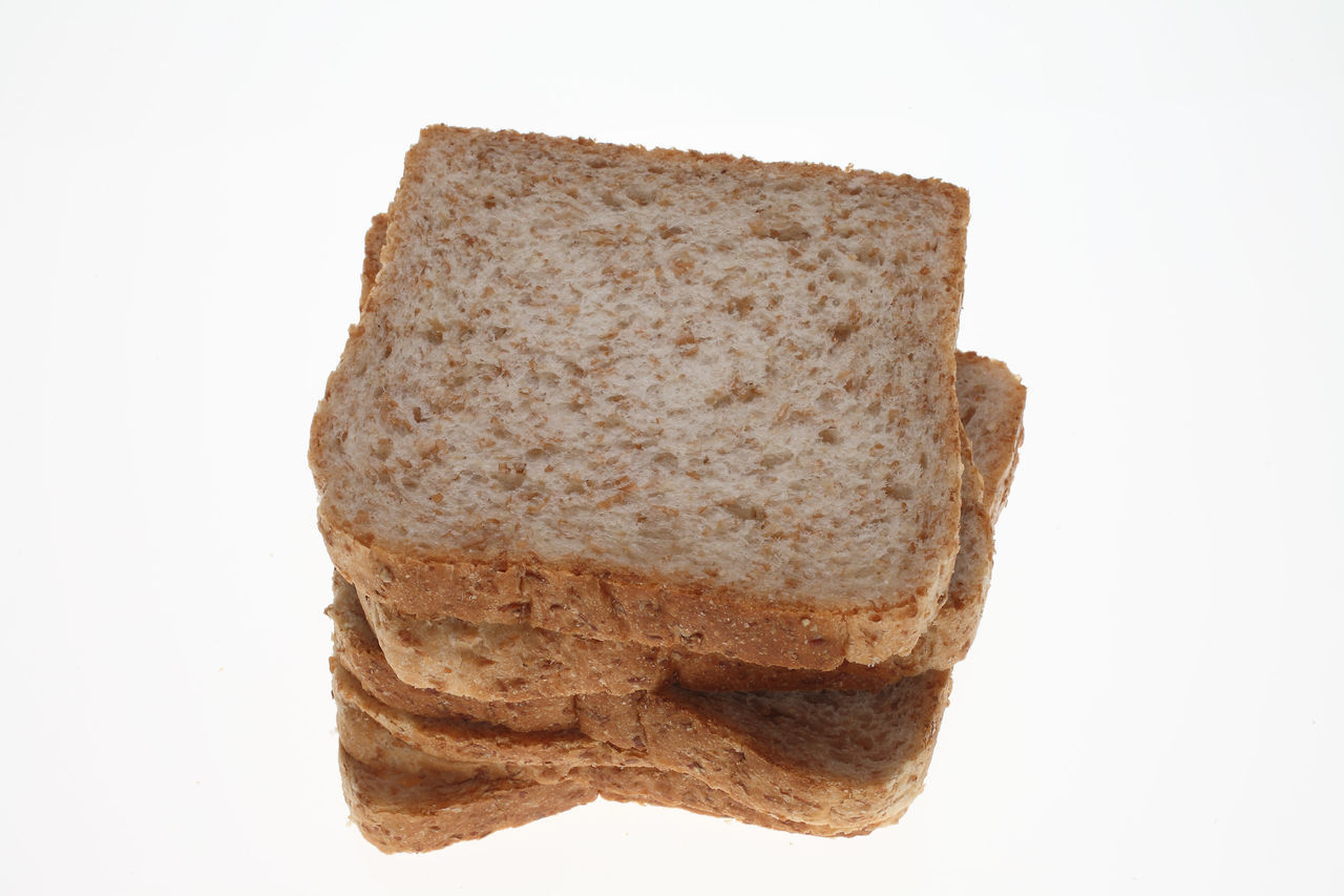 slices of Wholemeal toast bread on white Bread Brown Close-up Cut Out Freshness Geometric Shape Homemade Indulgence No People Ready-to-eat Slices Studio Shot Temptation Toastbread Toast🍞 White Background Wholemeal Wholemeal Bread