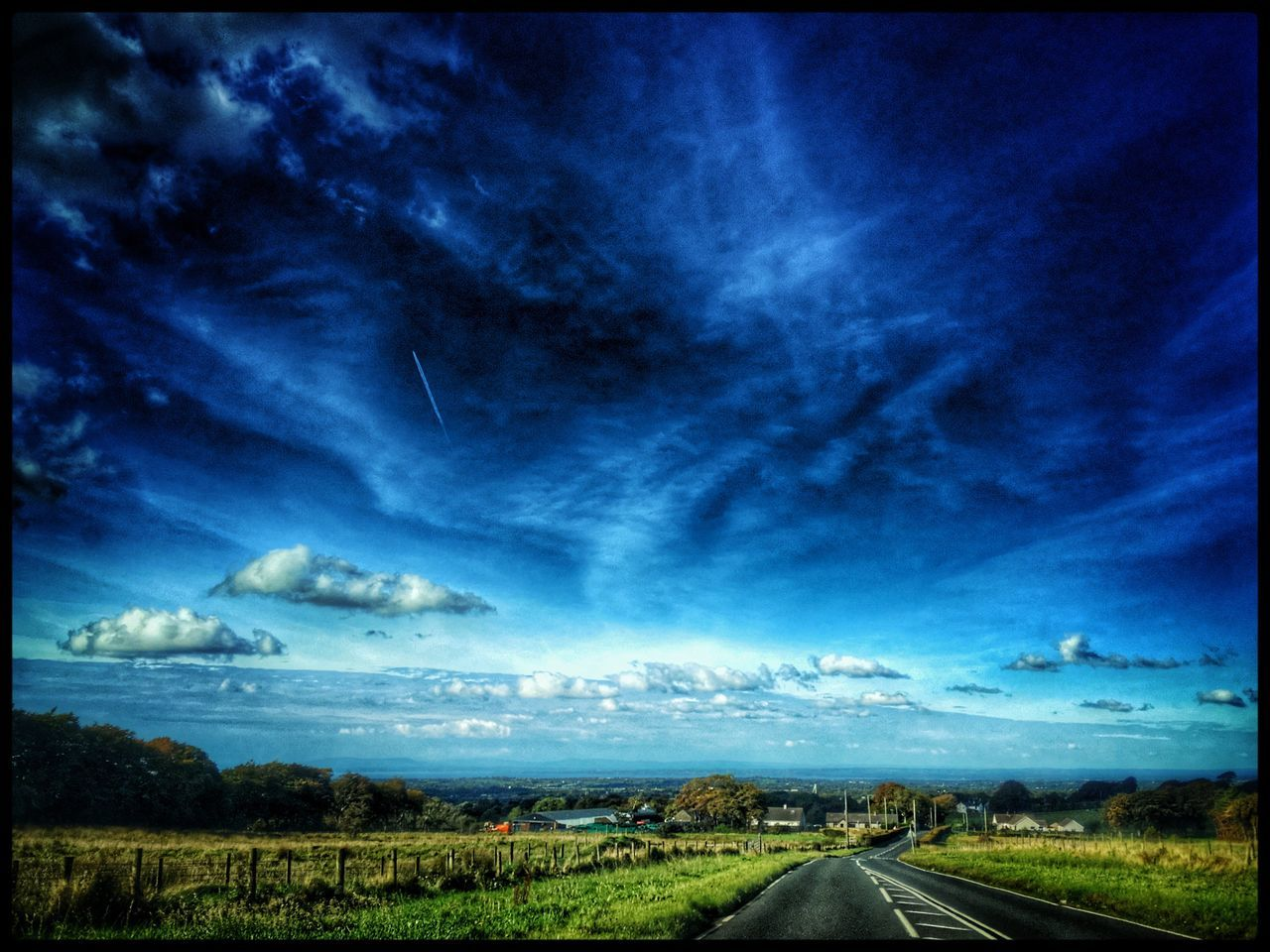 Landscape Tranquil Scene Blue The Way Forward Road Sky Transportation Tranquility Grass Scenics Solitude Countryside Non-urban Scene Field Plant Beauty In Nature Nature Cloud - Sky Diminishing Perspective Day