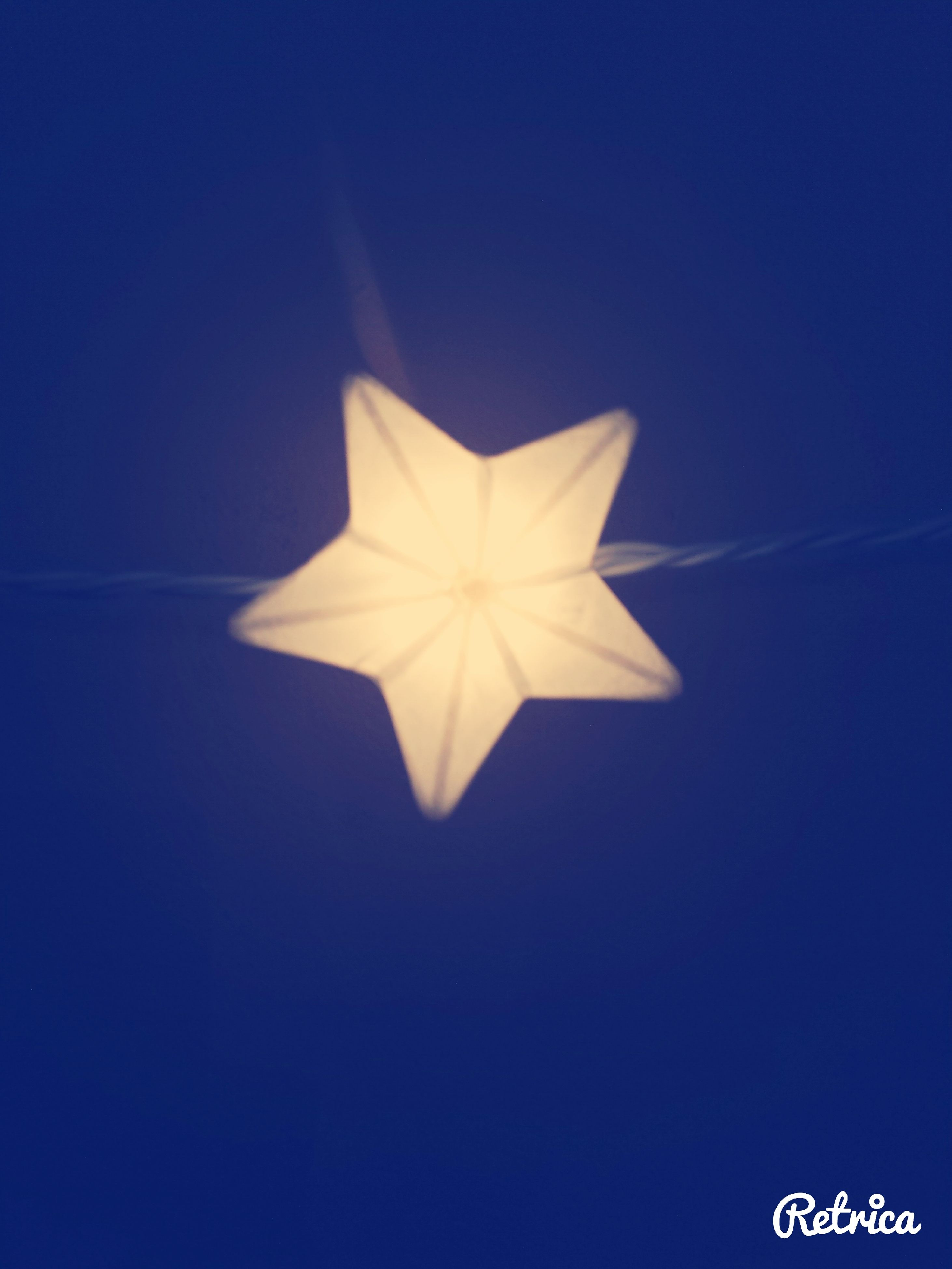 blue, copy space, studio shot, creativity, art and craft, star shape, art, indoors, close-up, decoration, still life, single object, low angle view, white color, clear sky, no people, pattern, design, hanging, paper