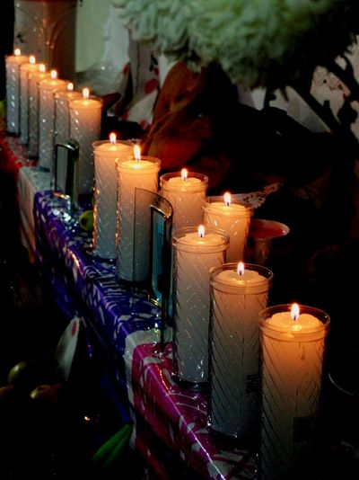 Caminos. Candle Flame Burning Indoors  Night Heat - Temperature Celebration No People Illuminated OfrendaFamiliar Celebration Ofrenda Al Dia De Muertos Dia De Muertos México Tradicionesmexicanas Tradition Mexico Arts Culture And Entertainment Multi Colored Spirituality Variation Candle