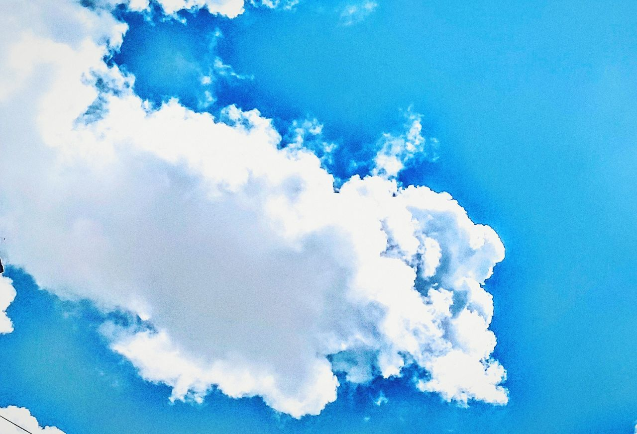 cloud - sky, sky, blue, sky only, cloudscape, beauty in nature, nature, scenics, low angle view, white color, day, backgrounds, tranquility, no people, outdoors, blue sky