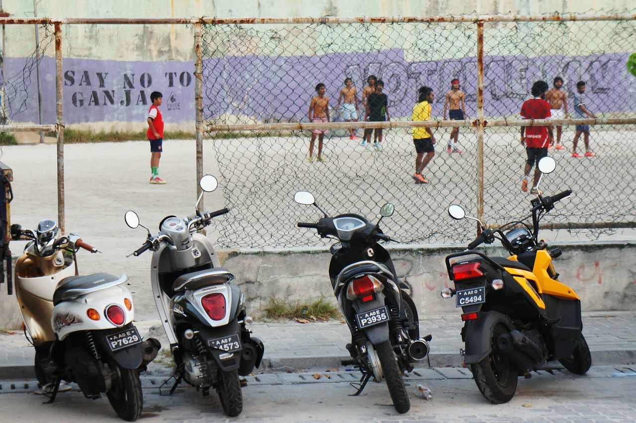 Adapted To The City Say NO to Ganja. Kids playing football in Male, Maldives Say No Ganja Drugs Say No To Drugs  Weed Football Kids Field Scooter Motorcycle Urban Urban Landscape Streetphotography Male Maldives People Of EyeEm City Life Streetart Grafitti Newstrekker Worldcaptures EyeEm Masterclass Sports Narcotic