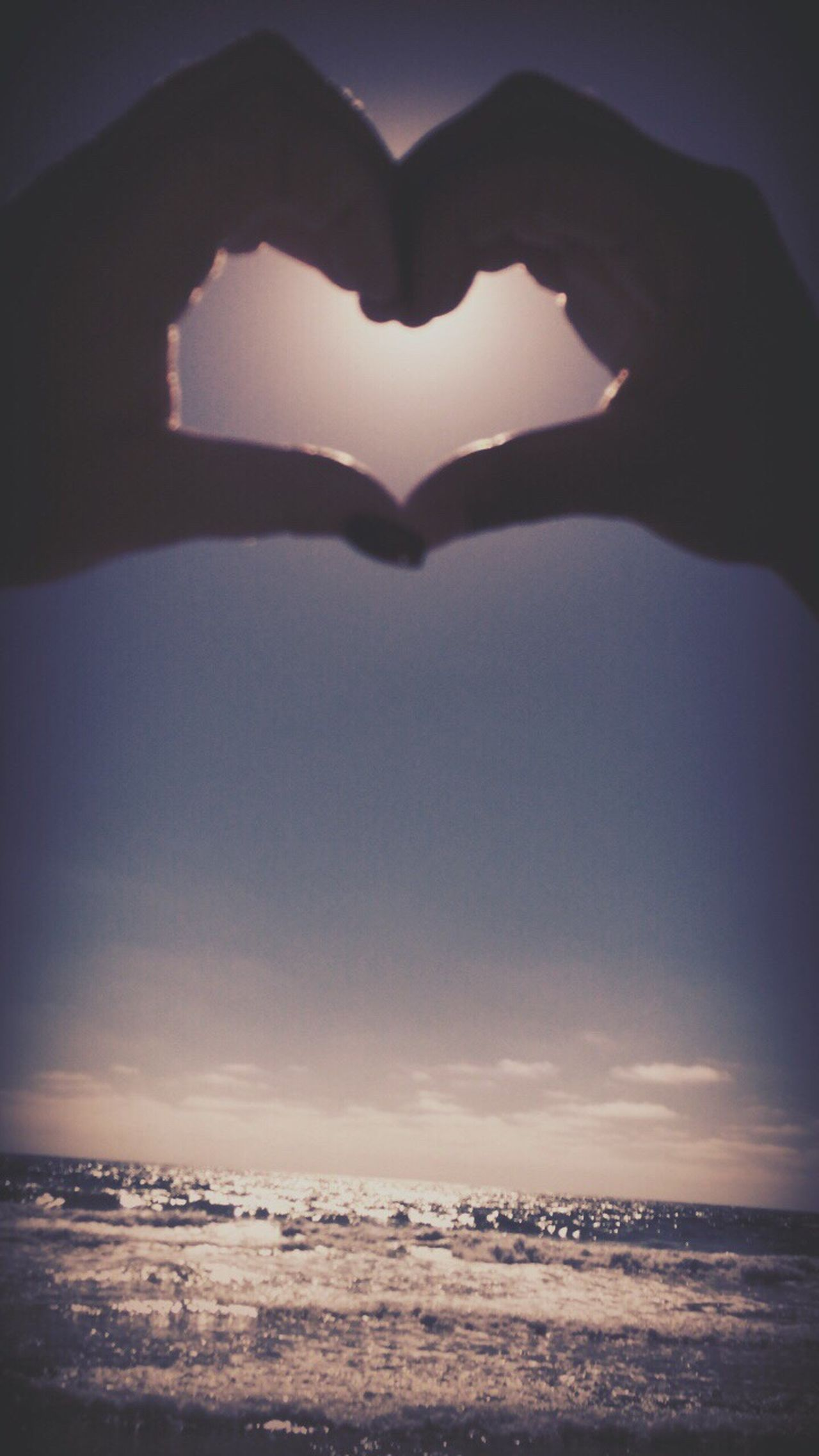 Heart Shape Forming Human Hand Love Sky Sunset Sea Scenics Human Body Part Nature Outdoors Beauty In Nature Water Real People Horizon Over Water Close-up Day One Person People