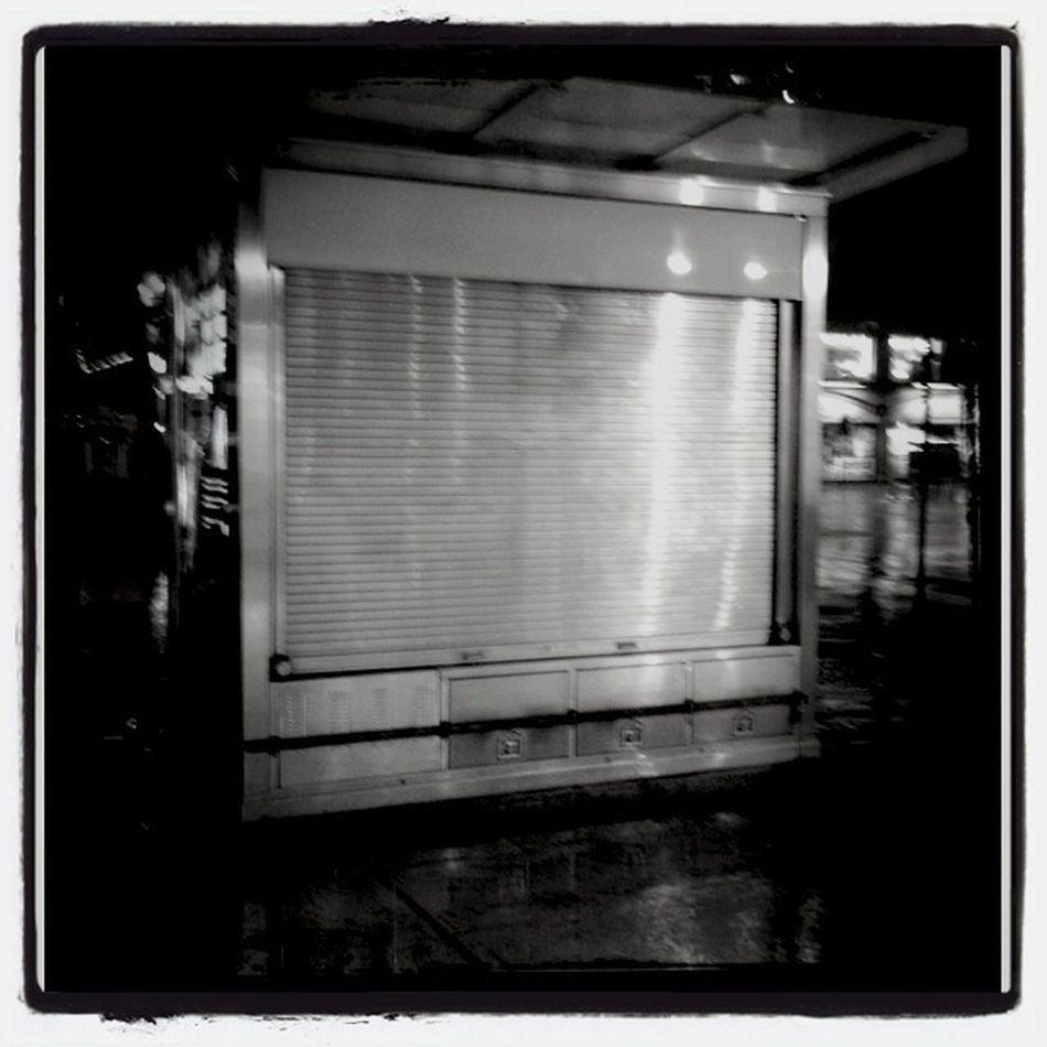 Newstand In Rain