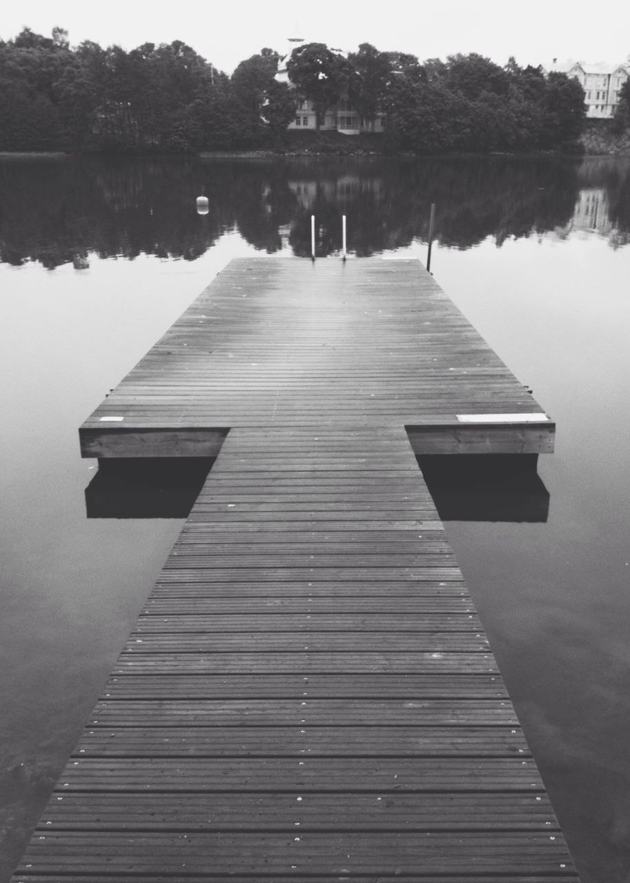 Wooden jetty leading to calm lake