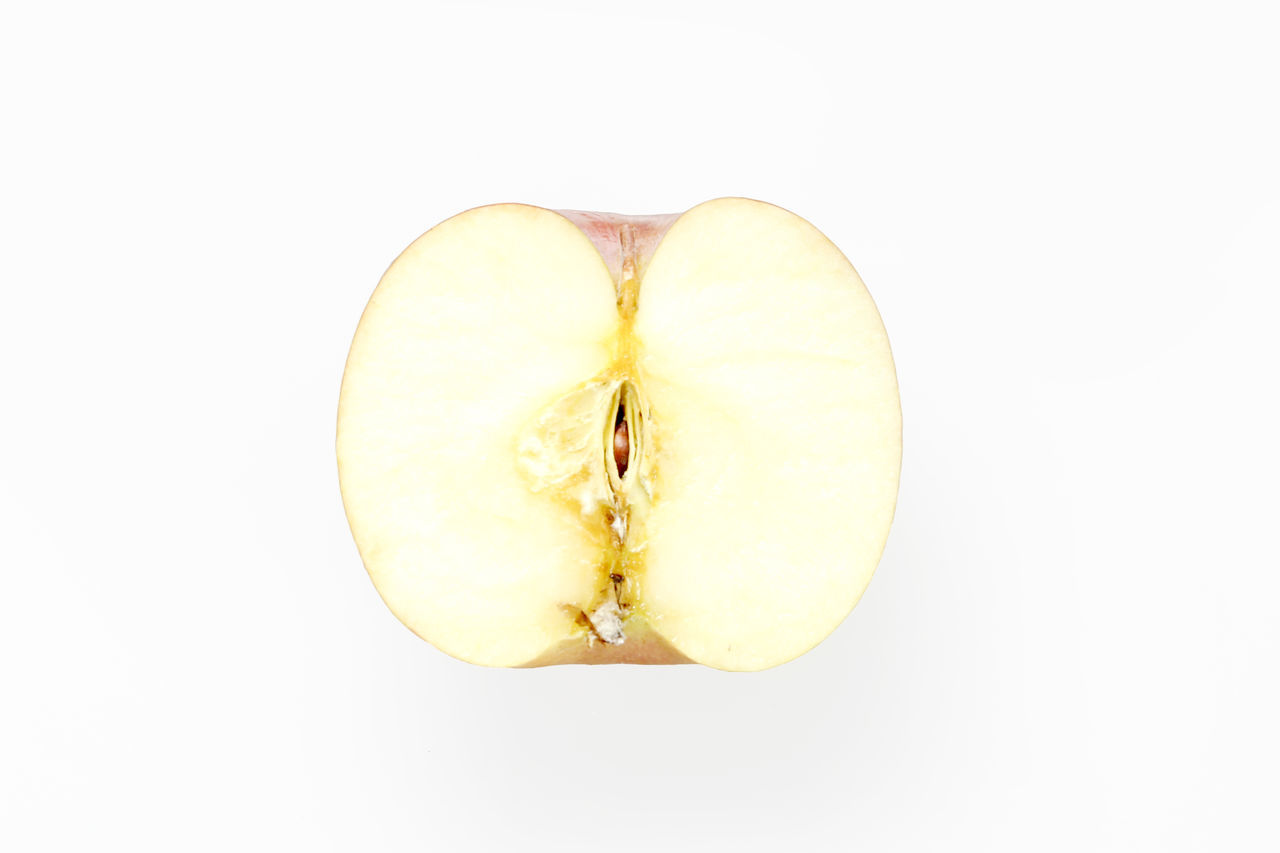 Cross Section Of Apple Against White Background