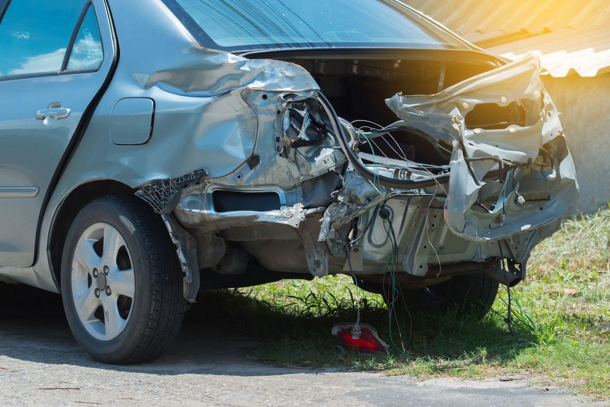 Rear of silver car get total damaged in accident. Damaged automobile. Automobile Sedan Collision Crash Car Damaged Car Insurance Claim Road Accident Silver Color
