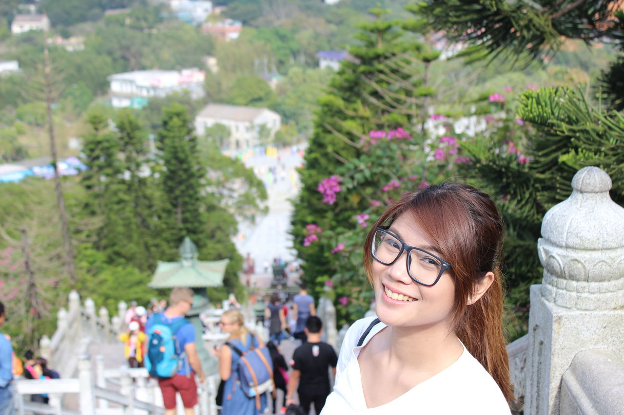 Women Headshot Portrait Young Adult People Adult Outdoors Tree Beauty Young Women Adults Only Day Smiling One Person Nature Only Women Close-up Tian Tan Buddha (Giant Buddha) 天壇大佛 HongKong Staircase Travel Photography Travel Destinations Real People Standing
